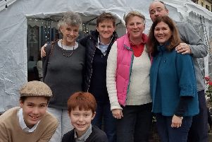 Anne (back row, left) and Andrea Lakeman (back row, middle) with family