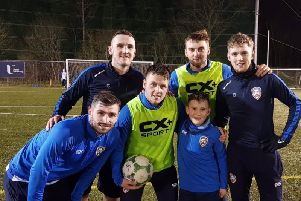 Cameron pictured with Coleraine players Cormac Burke, Stephen O'Donnell, Ben Doherty, Dylan King and Jamie McGonigle