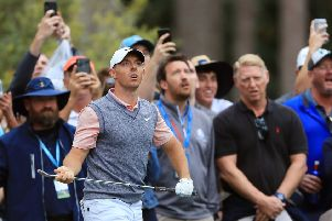 Rory McIlroy of Northern Ireland reacts to his second shot on the tenth hole during the third round of The Players Championship