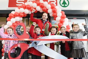 Students from St MacNissi's Primary School and Mossley Primary School mark the official opening with with Chris Currie.