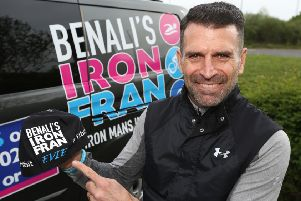 Former Premier League footballer Francis Benali shows off the cap he wore, bearing the name of a Melton schoolgirl who recently finished cancer treatment, which inspired him in his fundraising efforts to complete seven ironman triathlons EMN-191005-153111001