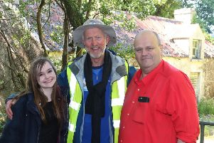 Brian Burnie (centre) with Deborah Kane and  Kevin McAuley  in Ballycastle