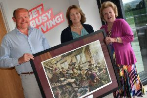 The president of Friends of the 10th, Lady Gretton, presents a limited edition print to Fred and Dawn Wilson, of  Burrough Court, which has provided land for a memorial to the 10th Battalion EMN-190529-133653001