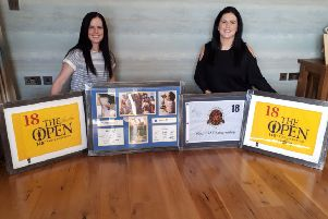 Golf auction organiser Patsy Trolan's daughters Ursula (left) and Aine (right) with some of the incredible items up for bidding in aid of Action Cancer