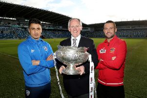 Paul McLean of BetMcLean pictured with Coleraine's Aaron Traynor and Gerard Kerr of Annagh United.