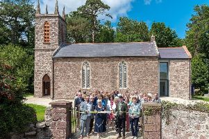 The Mayor of Causeway Coast and Glens, Sean Bateson, and Chair of Cushendun Building Preservation Trust, Monica Morgan, offically cut the ribbon to declare the Cushendun Old Centre open after 13 years of campaigning