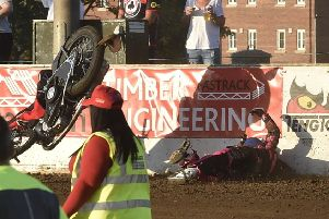Josh Bates lies prostrate on the ground as his bike flies through the air during the meeting with Belle Vue. Photo; David Lowndes.