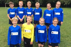 Osbournby Primary School pupils show off their new kit.