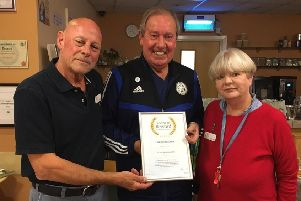 Leicester City FC legend, Alan Birchenall, aka The Birch, presents a certificate to Bob and Jane White for their work with the Melton branch of PROSTaid EMN-191010-160320001