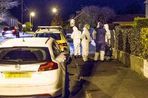 Police hold the scene of an incident at Rockfield Gardens in Mosside County Antrim on November 8, 2019