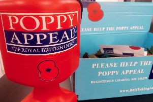 A poppy tin and box similar to the one stolen