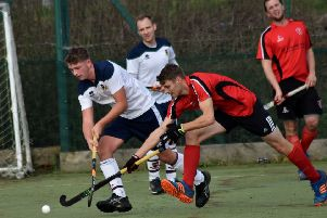 James Butcher chases down a loose ball for Melton First XI EMN-191119-123025002