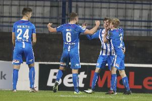 Alex Gawne celebrates his late winner for Coleraine