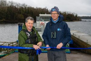 Brad Robson and former RSPB Fermanagh warden Joe Magee launch the conservation charitys new boat on Lower Lough Erne. The cot named the Joe Magee will be used to transport livestock on and off islands, with the animals grazing resulting in an ideal habitat for breeding wading birds including the endangered curlew. Funding for the cot came from the European Unions INTERREG VA Programme through the RSPB NI-led Co-operation Across Borders for Biodiversity (CABB) project.  Pictures: Ronan McGrade