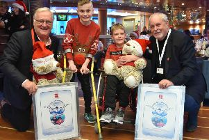 Oliver Dickey and Ethan Pollock are pictured with Colin Barkley, Chair, Northern Ireland Children to Lapland & Days To Remember Trust (NICTL) and Gerry Kelly