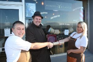Barber Beasts on The Promenade Portstewart was the winner of Causeway Coast and Glens Borough Council's Christmas window competition in Portstewart. Keith Stynes and Chloe Reeve are pictured receiving the award from Town and Village Officer Shaun Kennedy