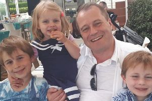 Photo issued by Garda of Conor McGinley, 9, Darragh McGinley, 7, and Carla McGinley, 3, with their father Andrew McGinley. The three children were found dead in a house in Parson's Court, in the village of Newcastle, which is south-west of Dublin city, on Friday night. PA Photo.