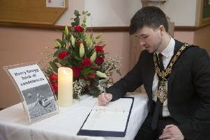 The Mayor of Causeway Coast and Glens Borough Council Councillor Sean Bateson signs a book of condolence in Coleraine Town Hall in memory of football legend Harry Gregg who passed away on Sunday, February 17 aged 87. The book will be open to the public in Coleraine Town Hall until Monday, March 2