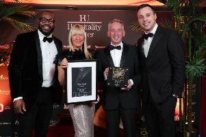 Trudy and Sean Brolly, Ocho Tapas Portrush pictured with England rugby player Ugo Monye and Ireland rugby star Tommy Bowe at the Hospitality Ulster Top 100 Hospitality Businesses Awards at the Crowne Plaza in Belfast