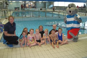 Pictured L to R at the launch of the Council's new getactiveabc Swim School at the Orchard Leisure Centre is the Stanley Swimming Lesson group, Jackie Timms, STA,  Laura Simpson, Swimming Teacher,  Emma Crawford, Swimming Coordinator,  Mark King, Swimming teacher and STA's mascot Stanley.