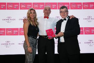 George Graham, General Manager of category sponsor Crowne Plaza Belfast and Strictly Come Dancing star and health and fitness advocate, Gemma Atkinson presents Gym Member of the Year Eddie Howarth with his trophy.