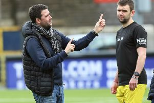William Dunlop with David Healy, manager of the Road Racers team, at the annual bike racers' charity football match at Seaview in January.