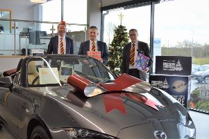 Santa's helpers (L-R): Colin Hutton, Used Car Sales Manager, Stephen Somerville, Sales Manager and Bob Stuart, Sales Executive.