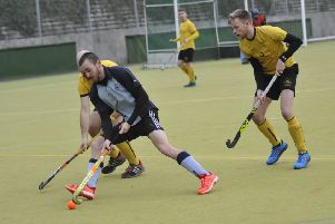 Alex Coombs takes on a pair of opposing defenders during South Saxons' 4-3 win at home to Marden Russets. Picture by Simon Newstead
