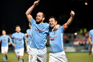 Ballymena United skipper Jim Ervin celebrates with team-mate Tony Kane, after scoring against Portadown.