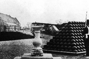 With the Royal Garrison Church in the background we see a mound of cannonballs used in the defence of the town. Photograph: Barry Cox collection.