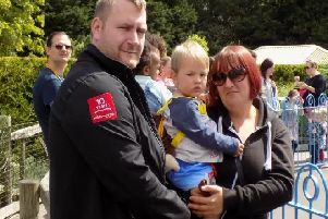 Andrew Bowell, Michelle Lawley and their son.