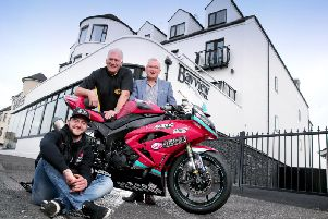 McAdoo Kawasaki Racing's Adam McLean with Armoy Clerk of the Course Bill Kennedy MBE, and Trevor Kane, owner of the Bayview Hotel in Portballintrae.