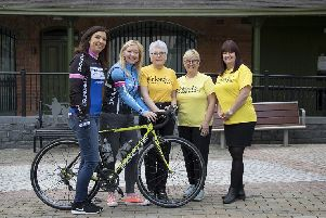Beth Reid, Janet Nelson and Claire Hogarth from Friends of the Cancer Centre help Dromore Cycling Club members Heather Dobbin and Andrea Quinn launch its Twelve Kings Challenge sportive taking place on June 16