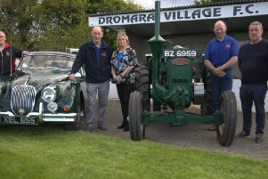 Dromara Vintage and Classic Club chairman Brian McGrillen (centre) with Gillian Owens treasurer of Dromara Village FC and members of the Vintage Club with two of the exhibits which will be on show this year