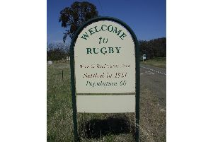 The 'Welcome to Rugby' road sign on the approach to the settlement in New South Wales, Australia