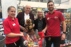 Evacuated Snuffy with his owners Derek and June Driver, is presented with a new bed, toys and treats by staff at the new Jollyes store in Skegness. The Drivers, who have no family or insurance, lost everything when their home was flooded.