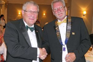 From left to right: Immediate past president Gordon Henderson hands over the chain of office to new president Graham Pemberton.