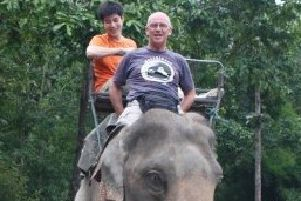 Charlie Graham takes an elephant ride during his time in Ethiopia