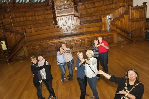 The Mayor of Derry City and Strabane District Council, Michaela Boyle pictured enlisting the help of some German tourists visiting the city to launch her new series of tea dances at the Main Hall, Guildhall on Wednesday morning.  Photo: Jim McCafferty Photography