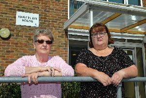 Cheryl Anderson, left, and Cindy Boreham, of Hart Plain House were furious that Guinness had left their block's front door broken for months 'Picture: Malcolm Wells (190821-6446)