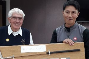 From left, Little Hay Golf Club President Ralph Lane presents Tong Tse with the Presidents Putter, which Tong has now won for three years on the trot.