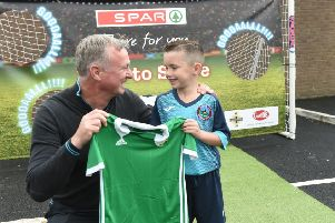 Riley Deans of the Greenisland 2011 team is presented with a Northern Ireland football shirt from team manager, Michael O'Neill after winning a penalty shootout in association with Ginster's, an official partner of the Irish FA at SPAR Fortfield's Customer Celebration event.