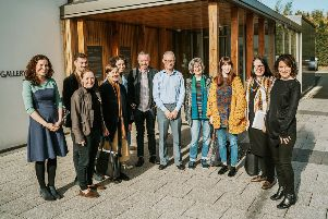 Linen Lab team at the F.E. McWilliam Gallery and Studio from left Riann Coulter, Curator and Manager, Deborah Malcomson, Arcibald Godts, Theresa Bastek, Jill Phillips, Robert Peters, Jason Diamond, Tourist Information Officer, Heather Richardson, Lyndsey McDougall, Rachel Fitzpatrick and Louise Rice, Linen Lab Project Lead