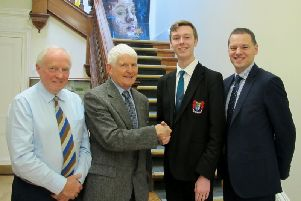 Pictured are Mr T Shields (Rotary), Mr L Boyd (Rotary), Joseph Garvey and Mr R S McLoughlin (Principal)