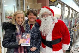 Carla and DUP leader Arlene Foster pictured with Santa