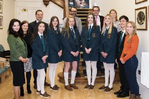 Mr McLoughlin alongside the pupils who were top candidates in GCSEs and their teachers.  From left to right the pupils are, Leah Donnelly, Susanna Elliott, Bethany Nixon, Susie Neill, Zara Ginniff and Jude Kennedy.  From left to right the teachers are Miss J Cosgrove, Mrs H Stewart, Mr R S McLoughlin, Mr G Robinson, Mr T Dempsey, Mrs G Johnston and Mrs S Tully
