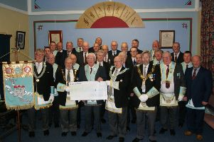 Spa Masonic Lodge 703 and Spa Royal Arch Chapter 703 members pictured presenting the cheque for �1,200 to The Grand Master of Irish Freemasons, M. W. Bro. Douglas T Grey