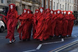 The Red Rebels coming down the Parade in Leamington. Photo by Kevin Ward