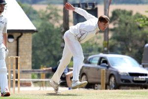 Westbury bowler Henry Chapman sends down a delivery against Sandford St Martin