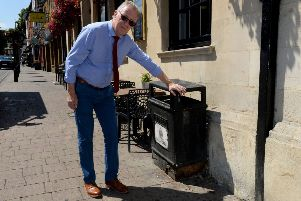 Malcolm Douglas of Henry's Menswear points out mess in Banbury High Street
